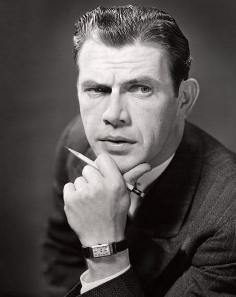 Vintage businessman with hand on chin looking intense focus.