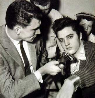 elvis being interviewed by reporters