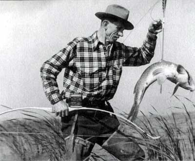 vintage man with bow and arrow fishing fish caught
