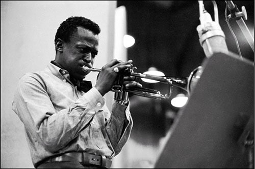 Miles Davis playing trumpet in studio