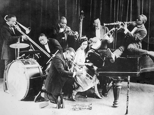joe king oliver jazz musician playing trombone on stage with band