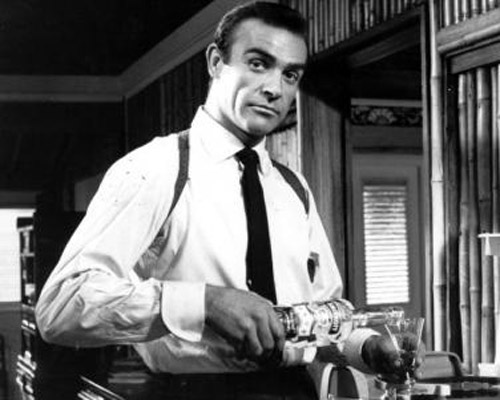 Sean Connery James bond pouring and drinking martini.
