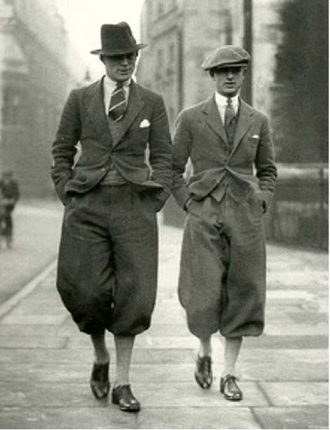 Vintage men walking down street with balloon pants.