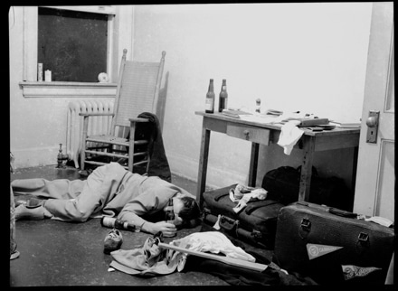 vintage college man passed on dorm room floor drunk