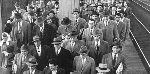vintage men at train station waiting on platform for trains