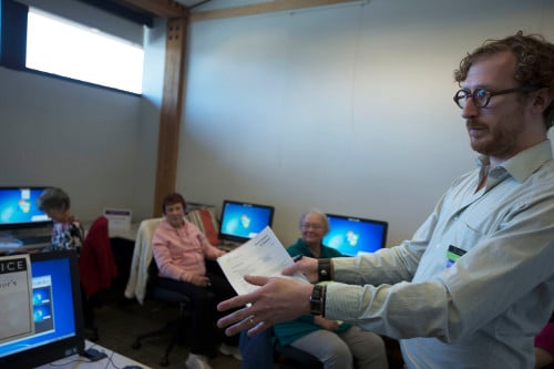 Librarian teaching a computer class.