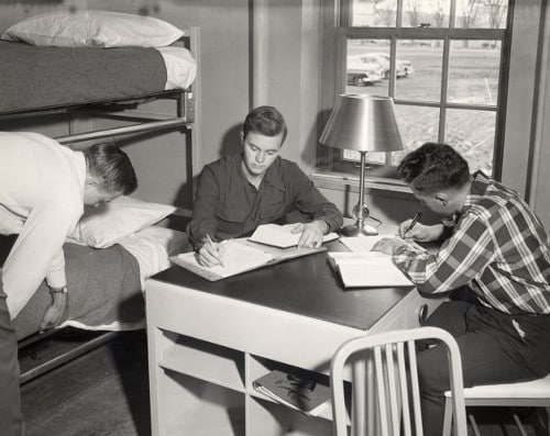 vintage college students working at desk in dorm room