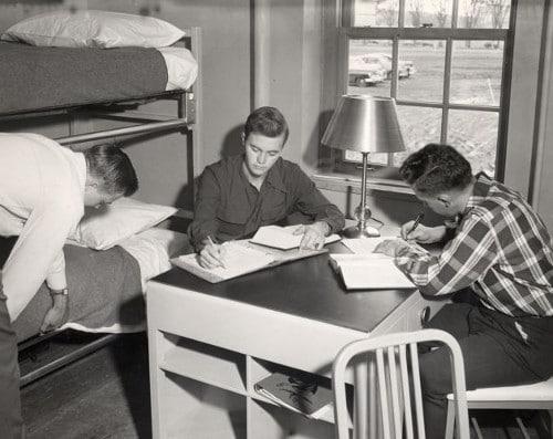 vintage college students working at desk in dorm room