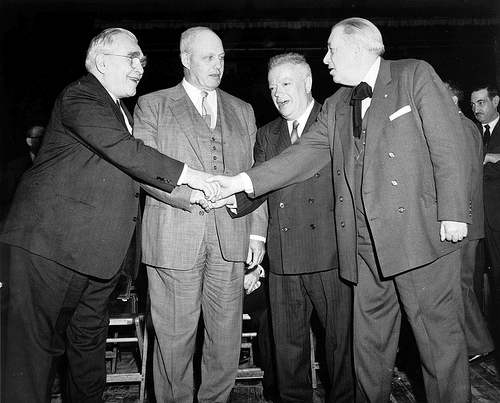 vintage group of men meeting shaking hands