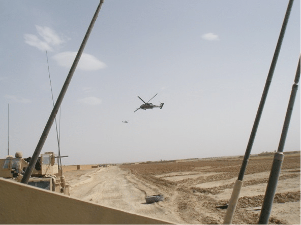 Helicopter flying in a construction area.