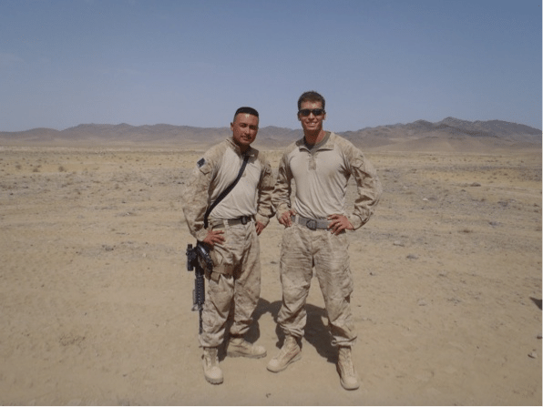 Two soldiers standing in a desert.