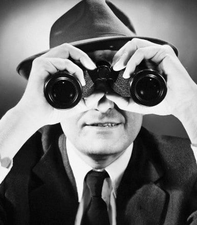 vintage man in suit detective with binoculars
