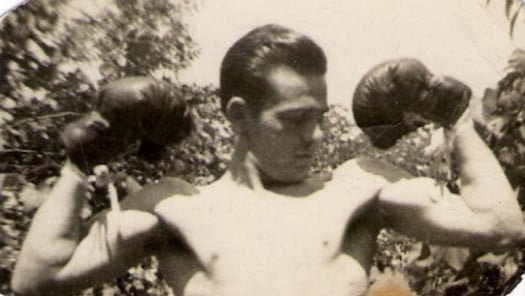 vintage man with boxing gloves on flexing biceps arms