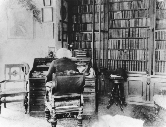 frederick douglass at desk in study library back turned