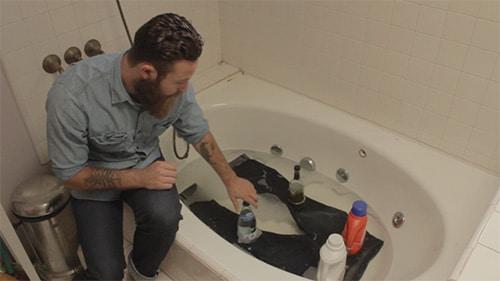 soaking washing raw denim jeans in bathtub