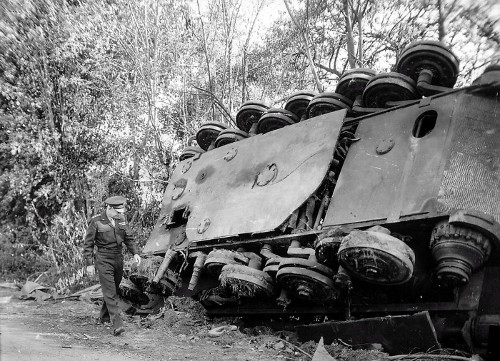 dwight d eisenhower wwii general walking in front of tank on its side