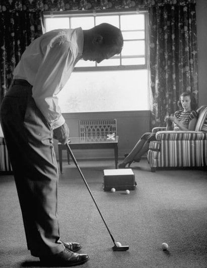 vintage man putting golfing in living room