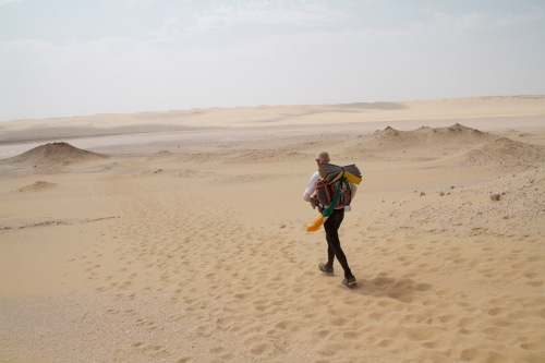 desert ultramarathon man running in sand