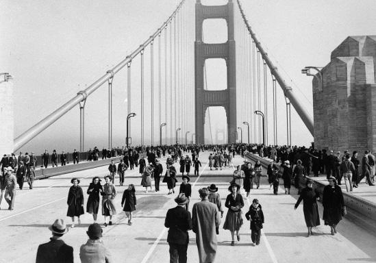 Vintage people walking across bridge.
