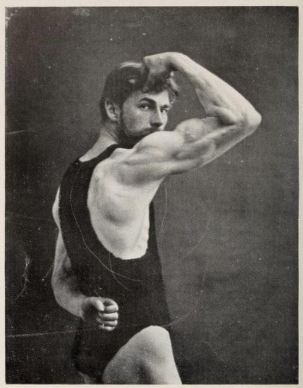 Adrian Peter Schmidt oldtime strongman posing bicep flex