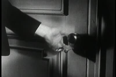 vintage man grabbing turning door knob handle close up photo
