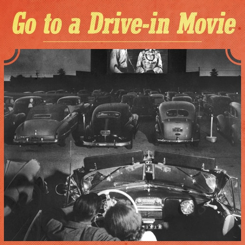vintage couple snuggling in car at drive-in movie