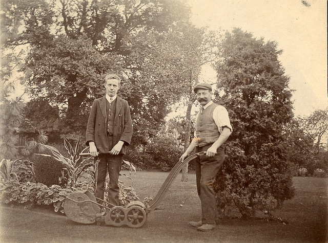 vintage men mowing lawn early 1900s