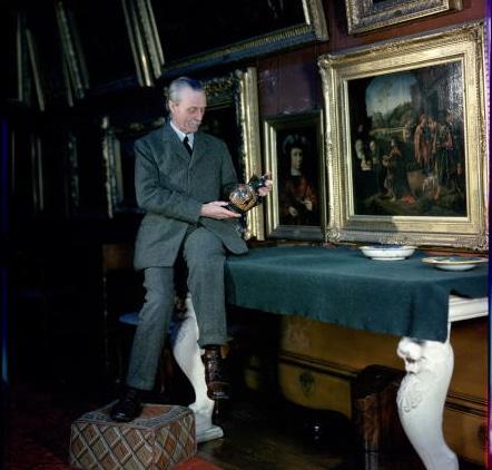 vintage man in art gallery examining art