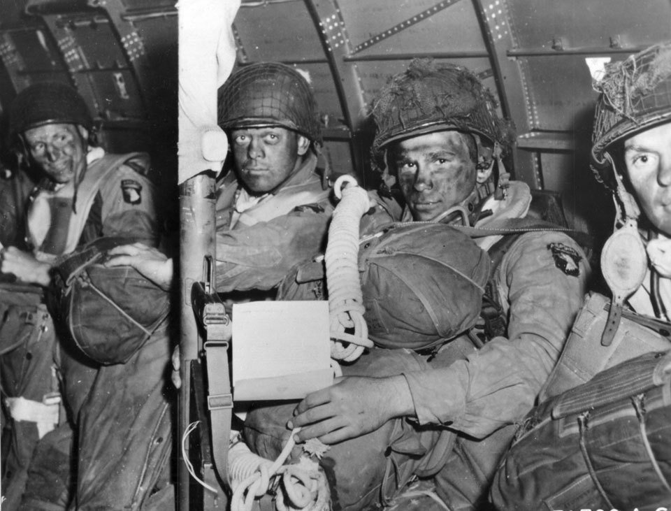 Vintage paratroopers in airplane camouflage paint on faces.