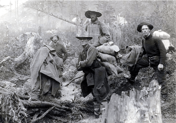 Vintage men wearing hats in forest.