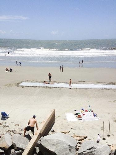 adult sized mega slip n slide on beach
