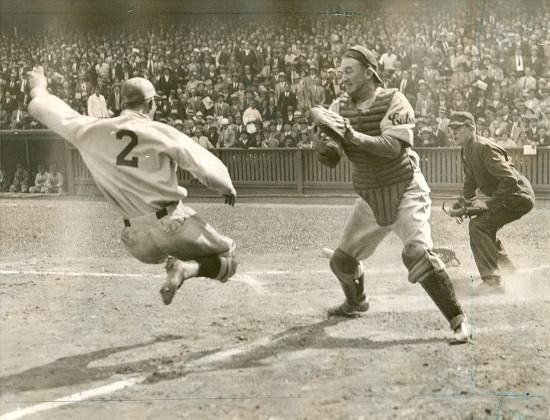vintage baseball game player sliding into home plate