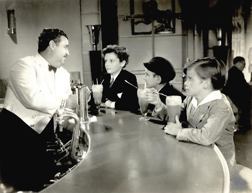vintage kids at soda fountain drinking egg cream