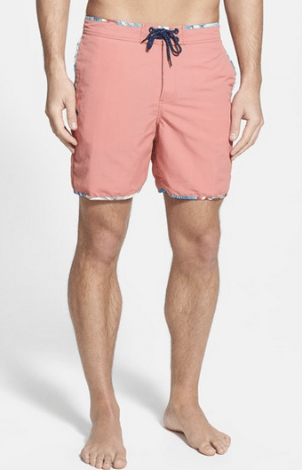 "For a good compromise between very long trunks and a short square-cut suit, look for shorts with a 6-7 inseam. This length has been coming into style of late. Brett in fact recently traded his self-described Hawaiian ""suburban dad"" shorts for this pair."