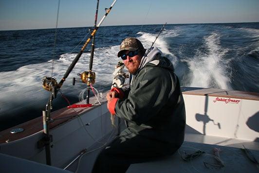 professional tuna fisherman at fishing pole on boat