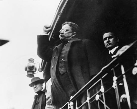 teddy theodore roosevelt giving speech arm raised in fist