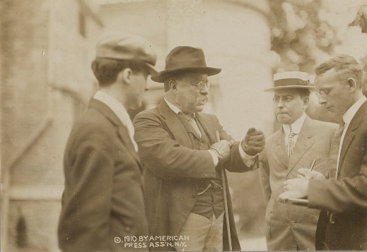 teddy theodore roosevelt talking out doors with group of men