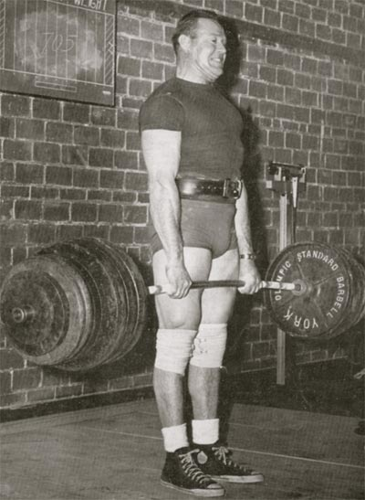 vintage man lifting deadlifting heavy barbell