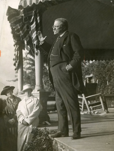 teddy theodore roosevelt giving speech on porch arm raised