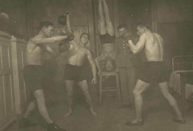 Vintage man amateur boxers boxing hitting speed bags.