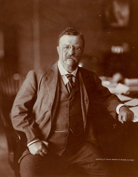 teddy theodore roosevelt portrait at desk 3 piece suit eyeglasses