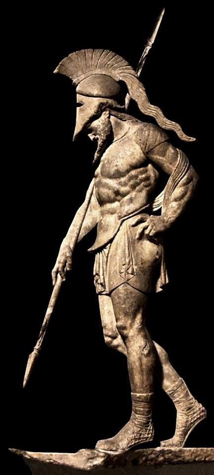 Ancient Greek warrior in metal armor statue.