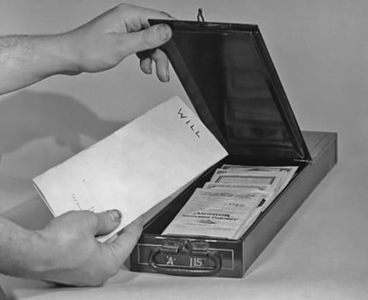 vintage man putting will into safety deposit box