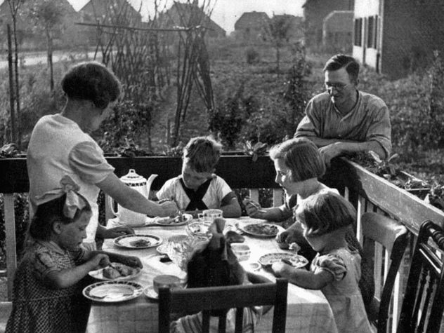 vintage family eating dinner outside on deck