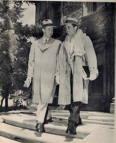 Vintage college men wearing overcoats.