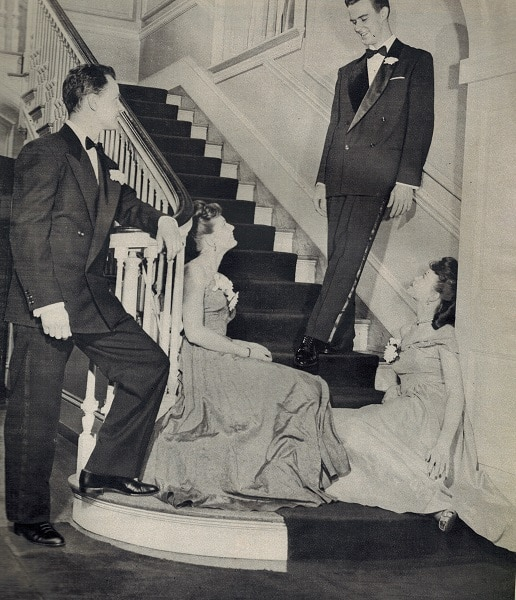 Vintage couples talk each others at home stairs.