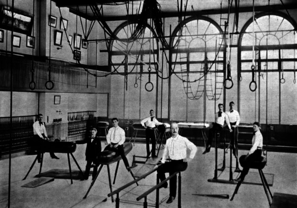 vintage old school gym gymnasium men sitting on gymnastics operatus