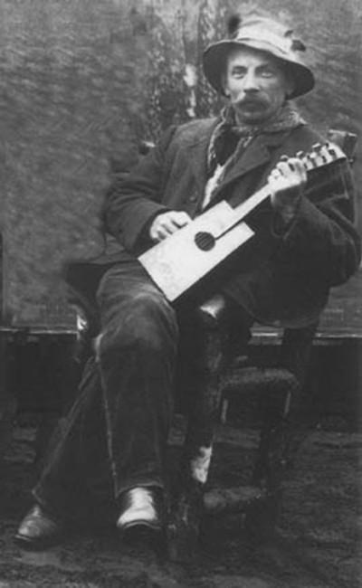 Vintage man playing guitar.