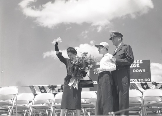 general douglas macarthur with wife and son in stadium