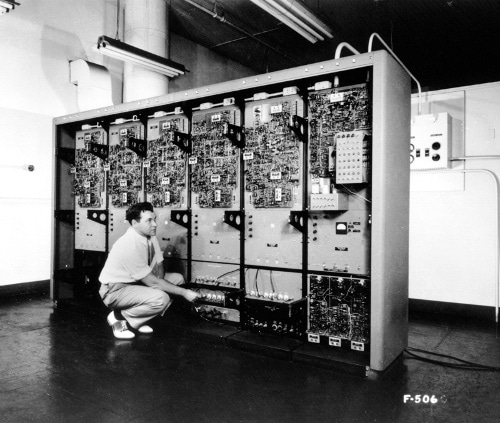 vintage man working on large old computer